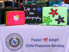 Port Neches-Groves High School students donated their suitcase art to foster children