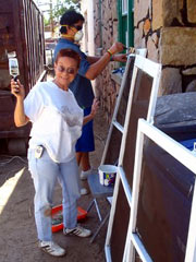 APS Investigator Janet Snow volunteered to paint