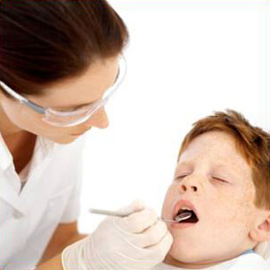 Dentist checking a child's teeth