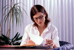 Woman psychiatrist looking at file
